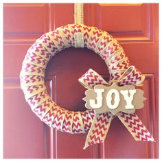 Simple Christmas wreath made with burlap red chevron ribbon from Jubilee Fabric.