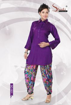 PURPLE STYLISH LONG KURTA by Snehal Creation. Perfect Purple Color Rayon Cotton fabric Kurta Style Kurti for women having plits pattern in the front with button embellishment. It looks attractive with printed patiala leggings.