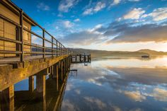 Pier sunrise - A very still and cold morning as the sun rose over the pier at Luss, on Loch Lomond, Scotland, UK.