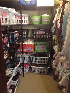 Laundry room/family closet - cheap metal shelving + laundry baskets = plenty of storage for kid stuff.