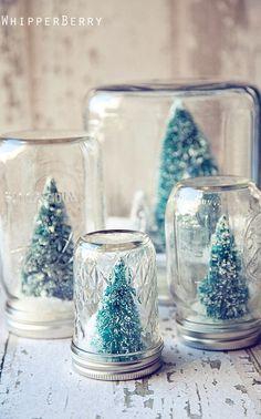 Sneeuw landschapjes in een glazen pot