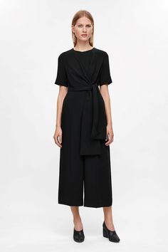 COS image 1 of Jumpsuit with draped top in Black