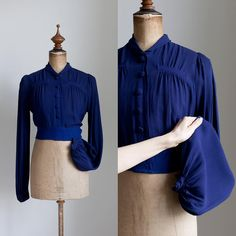 """{ Sold } This blouse has been an Instagram favorite, and I can see why. These dramatic 1930s sleeve blouses are getting rare and harder to find! This 30s midnight blue rayon blouse has a small rounded collar, shirred bodice, high waist and puff sleeves. Excellent condition, missing a button. Approx a size S-M. Bust 19"""", waist 16"""", shoulders 14.9"""", leeve length 26"""", total length 17 1/2"""". Dm to purchase!"""