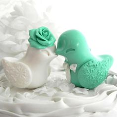 Hey, I found this really awesome Etsy listing at http://www.etsy.com/listing/106179035/wedding-cake-topper-love-birds-mint