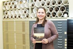 "Associate professor and digital project archivist Pamela Price Mitchem holds her pictorial history book released this week by Arcadia Publishing, titled ""Appalachian State University."""