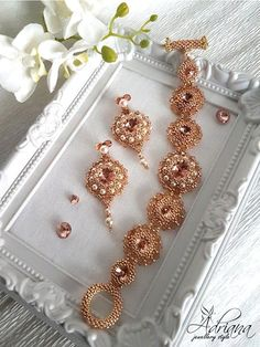 Rose Gold Beaded Jewelry Set Bracelet Earrings With Swarovski Crystals And Pearls. This delicate, rose gold, beaded jewelry set were created with Rhinnes crystals rivoli light peach, Swarovski crystals bicone beads light peach and crystals, Swarovski crystals pearls creamrose