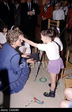A child loves Diana's hair.