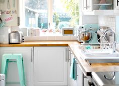 Such a pretty idea for using tiffany blue in the kitchen.  LOVE all the well-placed tiffany blue items spread throughout.