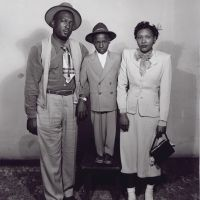 GREENVILLE, MISSISSIPPI  c. 1940-1960's  |  A Family of Three, Standing in the Studio. Though highly segregated, Greenville was the site of a thriving middle-class, African-American community.  (photographer: Henry Clay Anderson)