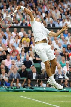 Roger Federer hits a leaping overhead to close out the third set of the semi-final match against Novak Djokovic. - Neil Tingle/AELTC