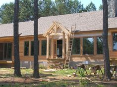 Timber frame entry porch on lake house