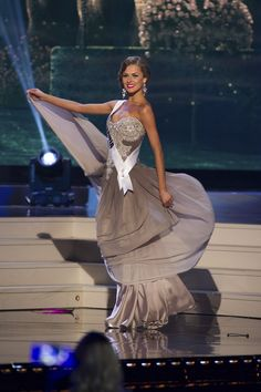Patricija Belousova, Miss Lithuania 2014 competes on stage in her evening gown during the Miss Universe Preliminary Show in Miami, Florida on January 21, 2015.