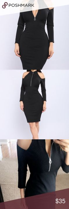 Black dress midi length cold shoulder Black dress cold shoulder and zipper in the front for sexy cleavage when desire. Fashion Nova Dresses Midi