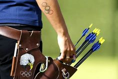 Caring for Archery Equipment: Storing and Transporting Arrows. Image: Team USA's Khatuna Lorig at the 2012 Olympic Games. The team's quivers were designed and donated by E.W. Bateman