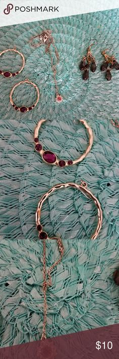 Jewelry Bundle Gold hoop earrings with purple stones are Avon, as is the y necklace with the pink stone. I'm not positive about the chandelier earrings. Avon Jewelry