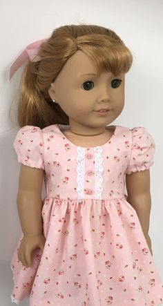 18 doll pink floral print dress and pink hair ribbon