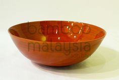 """""""orange bowl"""":suitable to serve salads or pasta or even as a fruit bowl, this big orange bowl is great for your home. brightens up your kitchen anytime of the day."""