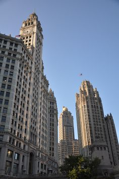 Wrigley Building (L). Architect: Graham, Anderson, Probst & White. South Tower Completed in 1921 - North Tower completed in 1924. Medinah Athletic Club (M). Architect: Walter W. Ahlschlager. Completed in 1929. Wrigley Building (L). Architect: Howells & Hood. Completed in 1925. Michigan Avenue Bridge Tender House (B). Architect: Edward Bennett. Completed in 1920. Magnificent Mile District. Chicago, Illinois USA. Photograph taken on July 28, 2012. Photograph by Zach Borders of Civic ArtWorks…
