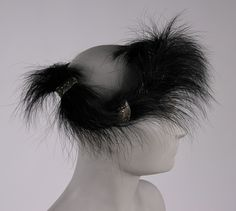 Woman's Headdress  Designed by Rose Valois, French  Geography: Made in Paris, France, Europe Date: 1946 Medium: Black feathers and beads on tulle