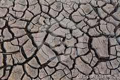 Dried clay or mud in a riverbed.