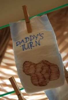 Baby Shower Game Diaper decorating contest Pass out a bunch of markers and diapers.  Each person decorates their diaper and hangs it up on the clothesline.  A couple of judges will pick the most creative one for a prize.  This diaper was the winner at this baby shower.