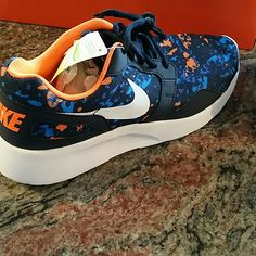 Nike athletic shoes Blue * Orange * white Brand new never used or worn. Men's size 9 which fits women's size 10.5 Shoes Athletic Shoes