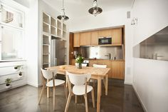 IKEA SPOTTED: Quotel Edition // EXPEDIT 2X4 bookcase on top of the fridge, EXPEDIT 1X5 bookcase flanking the fridge, NORDMYRA chairs, SVALBO...