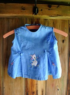 Blue 1960s vintage cotton shift dress with embroidered duck detail, and button fastening at the rear. 'Empire' made. Baby - 0-6 months