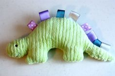 DIY - Dinosaur Taggy Toy - includes printable pattern and sewing instructions.