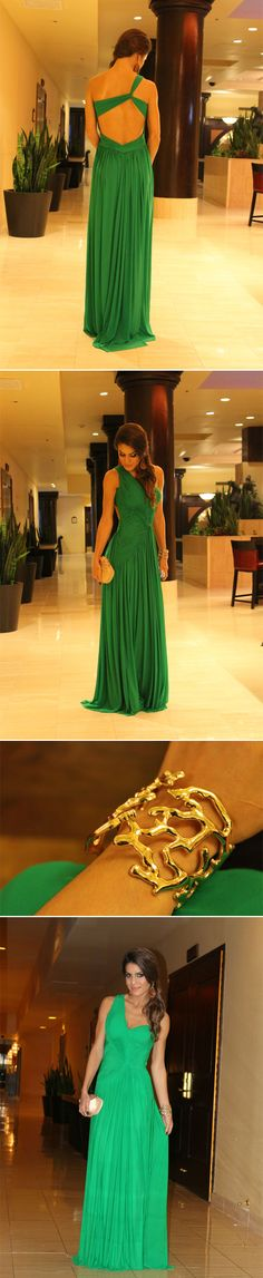 Ana's dress and jewelry for the Adopt-A-Family Affair in Chapter 5--Terani Couture emerald green one shoulder ruched gown with a cut-out back along with gold jewelry and a nude clutch with a large jeweled peacock.