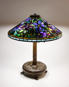 "** Tiffany Studios, New York, Favrile Leaded Glass and Patinated Bronze ""Clematis"" Lamp."