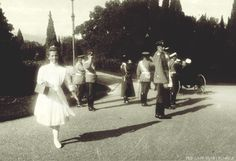 "Grand Duchess Maria Nikolaevna Romanova of Russia in the foreground. Officers in the back. ""AL"""
