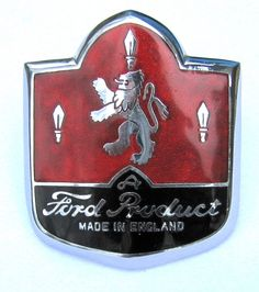 Ford Car Badge - Elegant Ford badge in chrome with red and black enamel and two fixing studs to rear. Fitted to the grille and boot of the Mark 1 Ford Consul, Zephyr and Zodiac. Probably manufactured by Joseph Fray, Birmingham, England. Ford Lincoln Mercury, Auto Logos, Bespoke Cars, Motos Vintage, Ford Zephyr, Car Bonnet, Car Hood Ornaments, Car Signs, Birmingham England