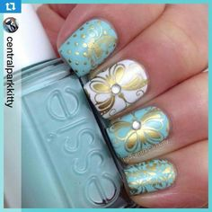 blue, white and gold nails.