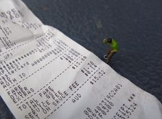 Little people scene: Size of receipt for general everyday shopping nowadays