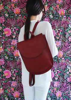 This luxurious half moon leather backpack from the new 2016 collection was crafted from high quality soft Italian leather in a rich burgundy color which sits beautifully and comfortably on your back.  Size: Width: 27 cm ( 10.5) Height - 33 cm ( 13 ) Depth - 9 cm ( 3.5 ) Double & stitched adjustable straps. One top handle This half moon burgundy leather backpack crafted with most attention to details without forgetting comfort and practicality. You would look glamorous whether you are wearing…