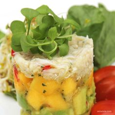 Mango and Avocado Tartar.  Ocean crab meat, ruccola lettuce, baby sprout and cranberry emulsion to tease your taste buds