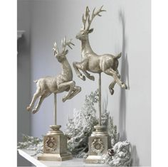 Silver deer and snow covered greenery centerpiece or vignette