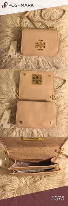 """Sale❗️Tory Burch Britten Combo Cross body NWT Tory Burch Britten Combo Crossbody! Color is light oak! 100% authentic  The design can be worn over the shoulder or across the body or carried as a clutch.  Pebbled leather Flap with magnetic snap closure Flat leather-and-chain adjustable, removable cross-body strap 1 interior zipper pocket,2 interior open pockets Height: 5.98""""  Length: 8.37""""  Depth: 2.51""""  No trades No lowballing ✅Bundle Discount  Authentic items  ✨purchase at listed price get…"""