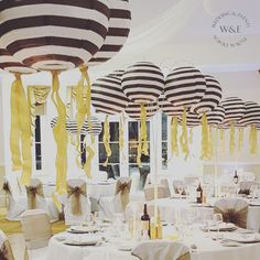 Black & White striped Paper Lanterns hanging from our fabulous Multi Arm  Tablestand centrepieces at Solberge