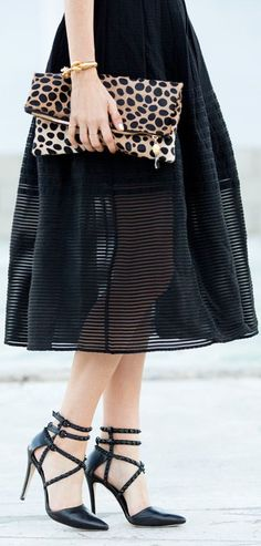 Love this combo! Sheer black skirt and leopard clutch with gold accents.