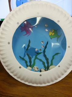 Misadventures of a YA Librarian: Porthole Fish Craft...looks like a fun summer craft activity.