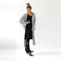 Our Kimono wrap in heather grey is a great layering piece. Made with Rayon from Bamboo blended with cotton and a little bit of Spandex. Available in s-m-l-xl in black, green, purple and brown.   www.jqlovesu.com