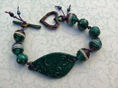 Drama    lampwork ceramic and enamelled bronze by PreciousViolet, £29.50