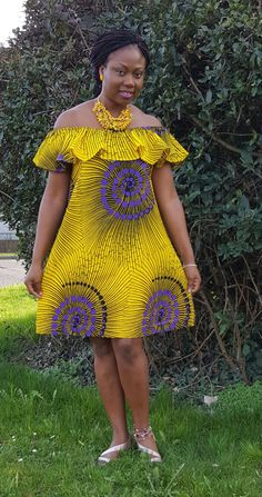 Yellow and Purple Off Shoulder Dress Bardot neck Short sleeves Relaxed fit Machine wash 100% Cotton Our model wears a UK 14 EU /42 US/10 36/US 4 and is 173cm/ 57 tall Mini dress length between: 86-88cm Variations Available on www.kelisafrica.co.uk