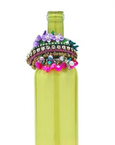 Painted bottle: Upcycle an empty bottle for jewelry storage. Get tips here at BeadStyleMag.com.