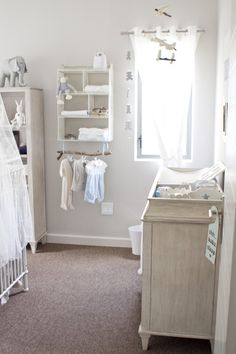 Project Nursery - use branch for curtain rod in nursery with cream curtains