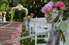 Ceremony under the gazebo at Grand Island Mansion. I like the flowers on the aisle seats