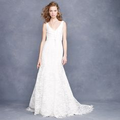 I am not a fan of sleeveless wedding dresses, but this one makes me swoon.