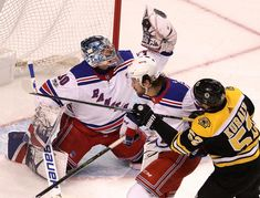 Boston, MA - 12/16/2017 - (2nd period) Boston Bruins center Sean Kuraly (52) could only watch as New York Rangers goalie Henrik Lundqvist (30)make a stellar glove save on this play during the second period. The Boston Bruins host the New York Rangers at TD Garden. - (Barry Chin/Globe Staff), Section: Sports, Reporter: Fluto Shinzawa, Topic: 17Rangers-Bruins, LOID: 8.4.376523049.